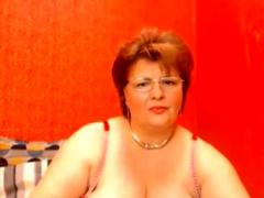 Mature granny masturbates as for oneself webcam innings