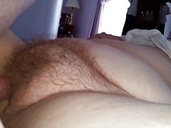 rubbing my cock on her hairy pussy mound